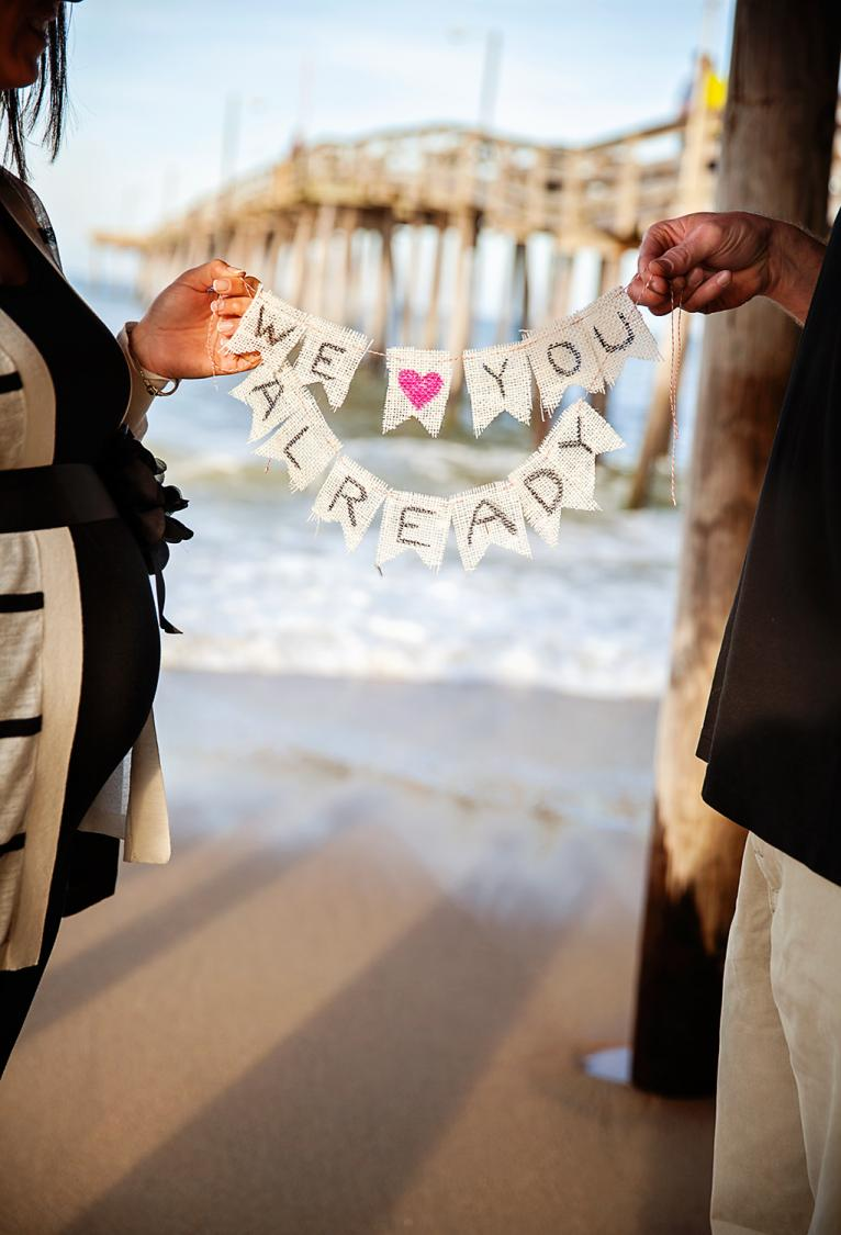 Pregnancy photo of couple at Nags Head Pier