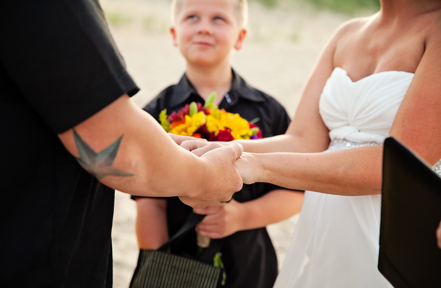 Wedding couple in Nags Head holding hands