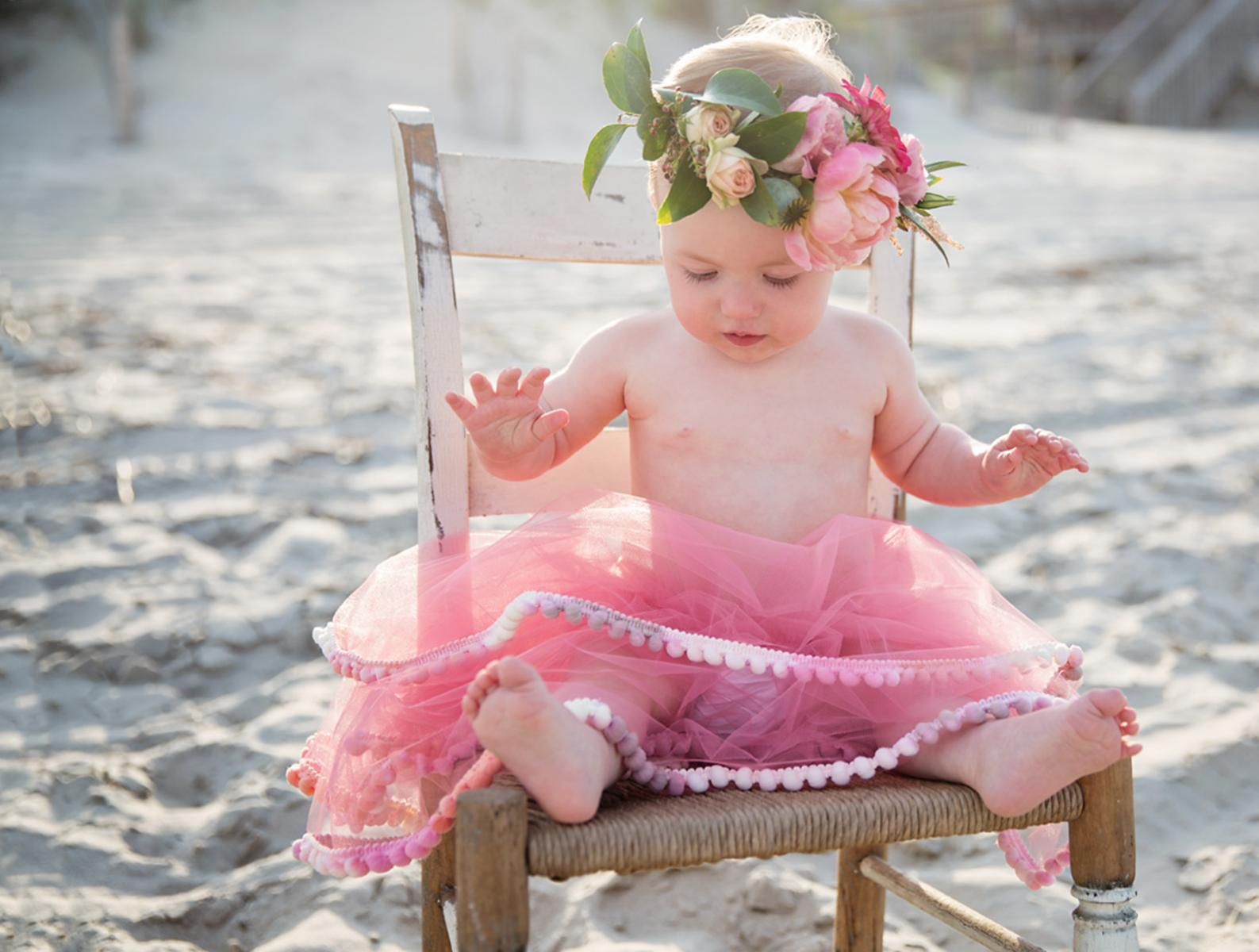 One year old girl photo with tutu and flower crown on beaches of Outer Banks NC