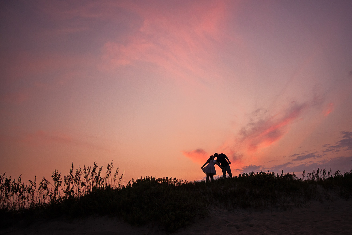 Engaged couple at sunset in Nags Head NC