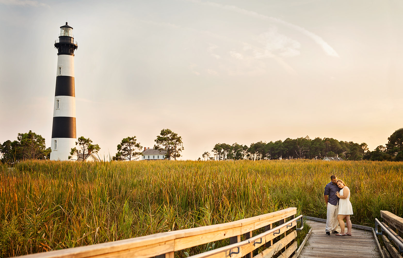Engaged couple at Bodie Island lighthouse
