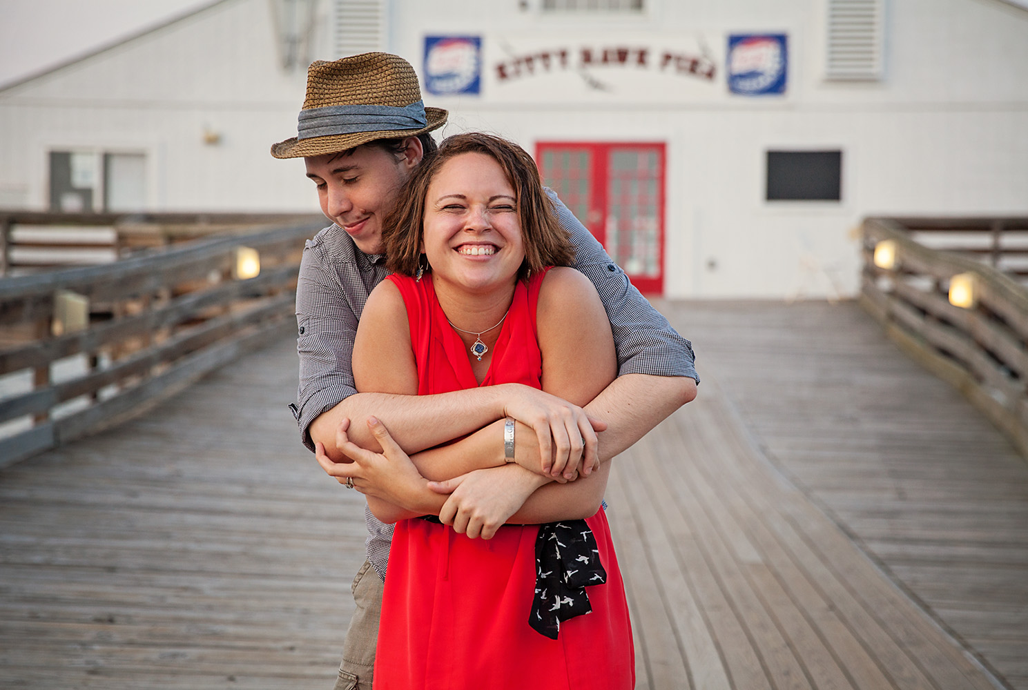 Engaged couple at Kitty Hawk Pier